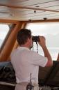 Captain Will Kaye on watch on the bridge of Big Aron