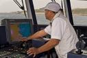 Captain manoveuring Ermis 2 from the wheelhouse