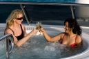 Elizabeth Flemming and Ceyni Pedersen enjoying champagne in the jacuzzi on the sun deck