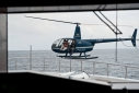 Helicopter taking pictures of Natori underway off Genoa