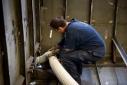 Worker aboard Hull 243 (ex Atlantis) under construction