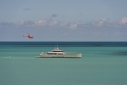 Exuma at anchor off Hermitage Bay from our room with a helicopter overhead